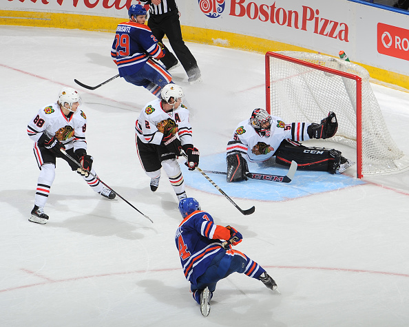 EDMONTON, AB - NOVEMBER 18: Corey Crawford #50 of the Chicago Blackhawks makes a big save in overtime on a shot from Taylor Hall #4 of the Edmonton Oilers on November 18, 2015 at Rexall Place in Edmonton, Alberta, Canada. (Photo by Andy Devlin/NHLI via Getty Images)