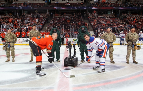 ANAHEIM, CA - NOVEMBER 11:  The 9th Civil Support Team stands by as the TALON HAZMAT Robot drops the puck to start the game between the Anaheim Ducks and the Edmonton Oilers on November 11, 2015 at Honda Center in Anaheim, California. (Photo by Debora Robinson/NHLI via Getty Images)