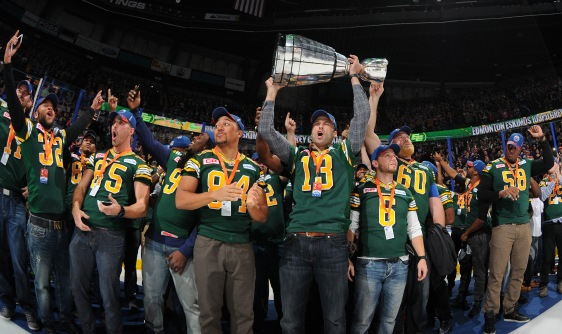 EDMONTON, AB - DECEMBER 2: Players of the Edmonton Eskimos salute the crowed prior to the game between the Edmonton Oilers and the Boston Bruins on December 2, 2015 at Rexall Place in Edmonton, Alberta, Canada. (Photo by Andy Devlin/NHLI via Getty Images)