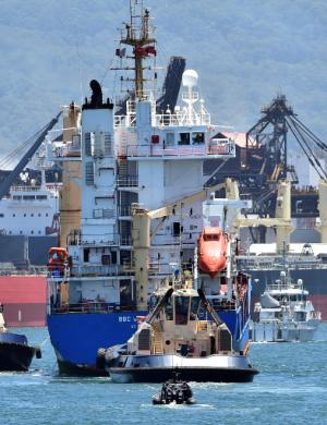 A police boat escorts a ship transporting reprocessed…