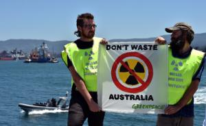 Greenpeace activists protest as a ship transporting…