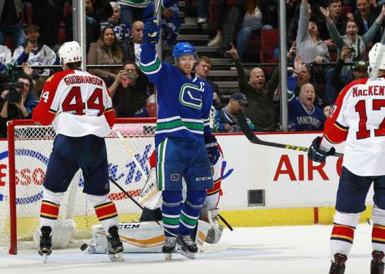 VANCOUVER, BC - JANUARY 11: Henrik Sedin #33 of the Vancouver Canucks celebrates after Daniel Sedin scores in overtime on Roberto Luongo #1 of the Florida Panthers as Erik Gudbranson #44 of the Panthers watches during their NHL game at Rogers Arena January 11, 2016 in Vancouver, British Columbia, Canada. Vancouver won 3-2. (Photo by Jeff Vinnick/NHLI via Getty Images)