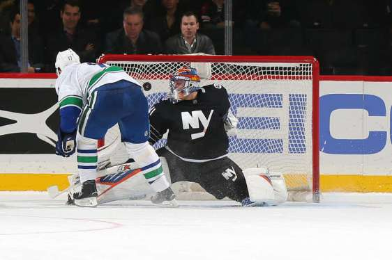 NEW YORK, NY - JANUARY 17: Radim Vrbata #17 of the Vancouver Canucks scores the game winning goal on Jaroslav Halak #41 of the New York Islanders in the shoot-out during the game at the Barclays Center on January 17, 2016 in Brooklyn borough of New York City. (Photo by Mike Stobe/NHLI via Getty Images)