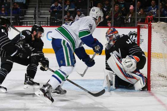 NEW YORK, NY - JANUARY 17: Jaroslav Halak #41 of the New York Islanders makes a save on Bo Horvat #53 of the Vancouver Canucks during the game at the Barclays Center on January 17, 2016 in Brooklyn borough of New York City. (Photo by Mike Stobe/NHLI via Getty Images)