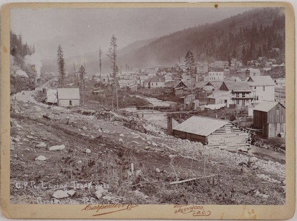 "C.P.R. Laying Track into Greenwood, B.C. Ca. early 1900s. ""Carpenter & Co. Rossland, Greenwood, B.C."""