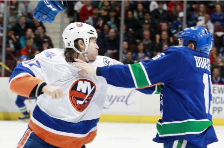 VANCOUVER, BC - MARCH 1: Matt Martin #17 of the New York Islanders and Derek Dorsett #15 of the Vancouver Canucks fight during their NHL game at Rogers Arena March 1, 2016 in Vancouver, British Columbia, Canada. (Photo by Jeff Vinnick/NHLI via Getty Images)