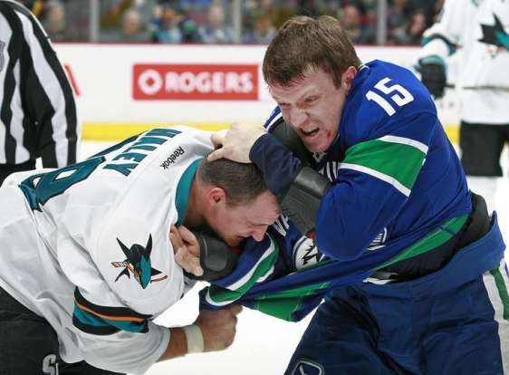 VANCOUVER, BC - MARCH 3: Derek Dorsett #15 of the Vancouver Canucks and Micheal Haley #38 of the San Jose Sharks fight during their NHL game at Rogers Arena March 3, 2016 in Vancouver, British Columbia, Canada. (Photo by Jeff Vinnick/NHLI via Getty Images)