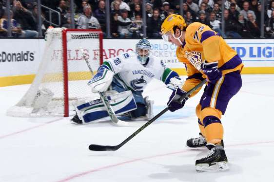 LOS ANGELES, CA - MARCH 7: Tyler Toffoli #73 of the Los Angeles Kings takes a backhand shot against Ryan Miller #30 of the Vancouver Canucks on March 7, 2016 at Staples Center in Los Angeles, California. (Photo by Juan Ocampo/NHLI via Getty Images)