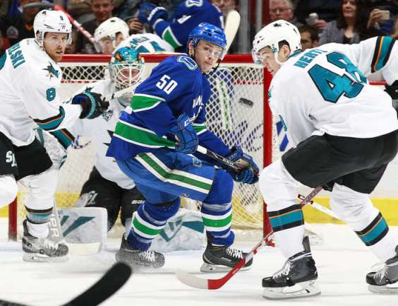 VANCOUVER, BC - MARCH 29: Joe Pavelski #8 of the San Jose Sharks and Brendan Gaunce #50 of the Vancouver Canucks watch the puck in front of Tomas Hertl #48 of the Sharks during their NHL game at Rogers Arena March 29, 2016 in Vancouver, British Columbia, Canada. (Photo by Jeff Vinnick/NHLI via Getty Images)