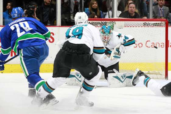 VANCOUVER, BC - MARCH 29: Chris Higgins #20 of the Vancouver Canucks beats James Reimer #34 of the San Jose Sharks for a shorthanded goal during their NHL game at Rogers Arena March 29, 2016 in Vancouver, British Columbia, Canada. (Photo by Jeff Vinnick/NHLI via Getty Images)