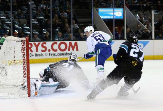 SAN JOSE, CA - MARCH 31: Bo Horvat #53 of the Vancouver Canucks scores a goal on Martin Jones #31 of the San Jose Sharks at SAP Center on March 31, 2016 in San Jose, California. (Photo by Ezra Shaw/Getty Images)
