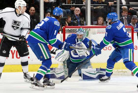 Los Angeles Kings vs. Vancouver Canucks VANCOUVER, BC - APRIL 4: Milan Lucic #17 of the Los Angeles Kings, Christopher Tanev #8 and Dan Hamhuis #2 watch Ryan Miller #30 of the Vancouver Canucks make a save during their NHL game at Rogers Arena April 4, 2016 in Vancouver, British Columbia, Canada. (Photo by Jeff Vinnick/NHLI via Getty Images)