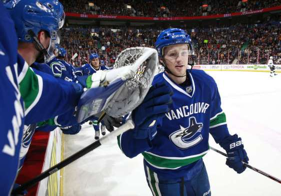 VANCOUVER, BC - APRIL 4: Jared McCann #91 of the Vancouver Canucks is congratulated at the bench after scoring against the Los Angeles Kings during their NHL game at Rogers Arena April 4, 2016 in Vancouver, British Columbia, Canada. Vancouver won 3-2. (Photo by Jeff Vinnick/NHLI via Getty Images)