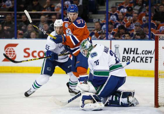 EDMONTON, AB - APRIL 6: Connor McDavid #97 of the Edmonton Oilers can't get a shot past goaltender Jacob Markstrom #25 of the Vancouver Canucks on April 6, 2016 at Rexall Place in Edmonton, Alberta, Canada. The game is the final game the Oilers will play at Rexall Place before moving to Rogers Place next season. (Photo by Codie McLachlan/Getty Images)